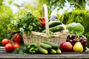 Fresh organic vegetables in wicker basket in the garden